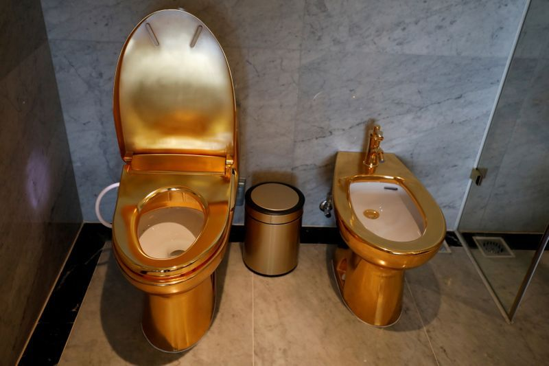 Gold-plated toilets are seen at the newly inaugurated Dolce Hanoi Golden Lake hotel, after the government eased nationwide social distancing following the global outbreak of the coronavirus disease (COVID-19), in Hanoi, Vietnam. Photo: Reuters