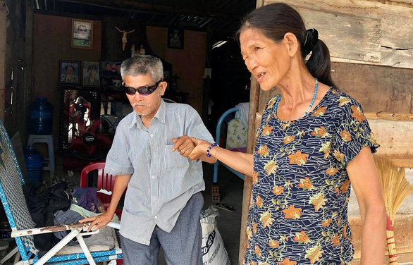 Lan, 62, has only one barely working eye. She sometimes takes him for a walk around their makeshift cottage. Photo: D.Q.
