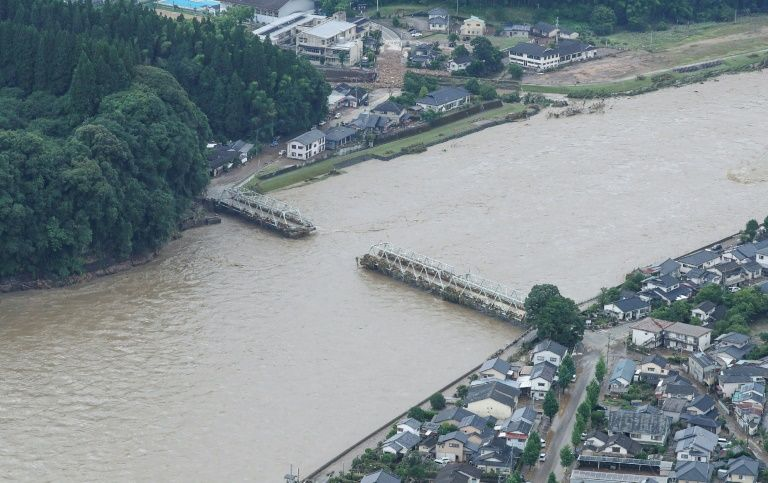 A bridge over the Kuma River in Hitoyoshi, Kumamoto prefecture is washed away by the floods, July 4, 2020. Photo: AFP