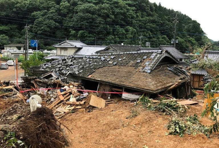 A house collapses during a landslide caused by torrential rain in Ashikita, Kumamoto prefecture, Japan, July 5, 2020. Photo: AFP