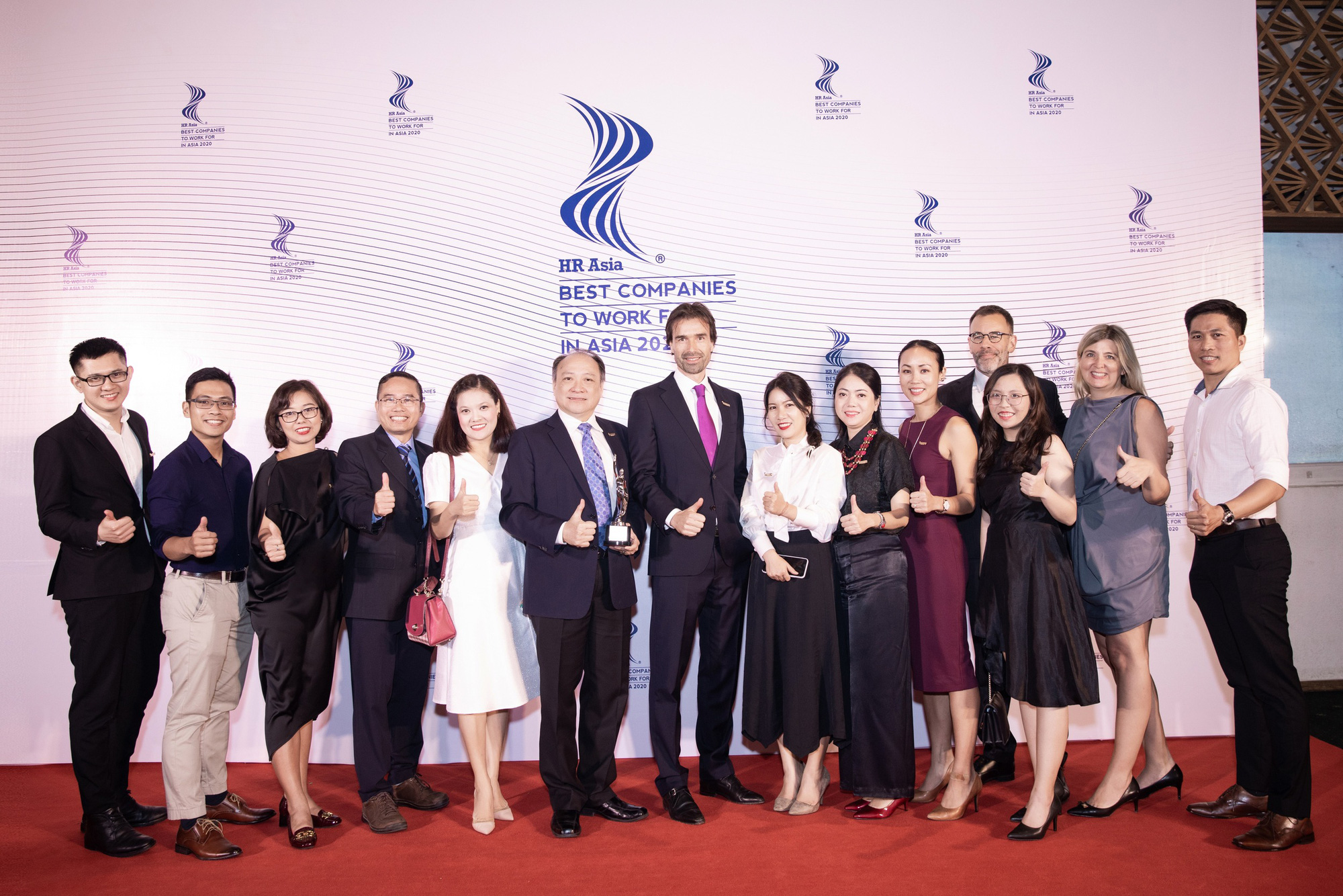 HEINEKEN Vietnam leaders and employees pose for a photo at the Best Companies to Work For in Asia award ceremony in Ho Chi Minh City, July 1, 2020.