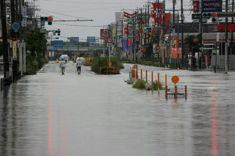 Rains turn a road into river in Japan, July 7, 2020. Photo: AFP