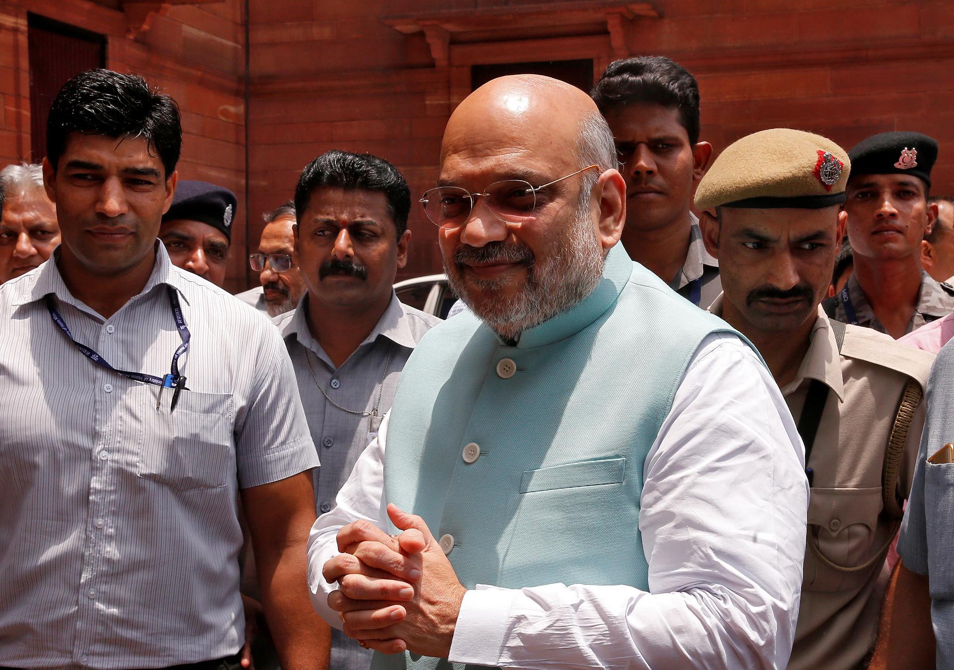 India's interior minister hospitalised with coronavirus