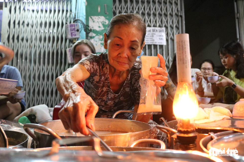 Septuagenarian's sweet dessert stall a nostalgic, nightly fixture on Saigon sidewalk
