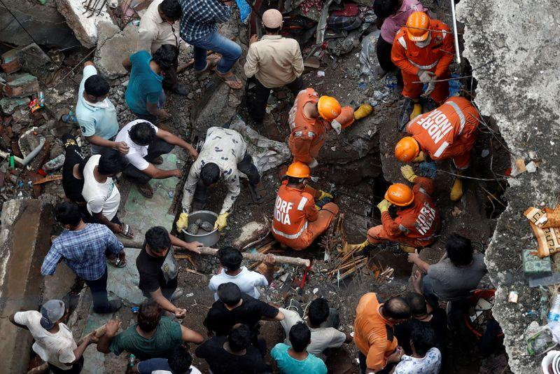 India building collapse death toll climbs to 20, second day search underway