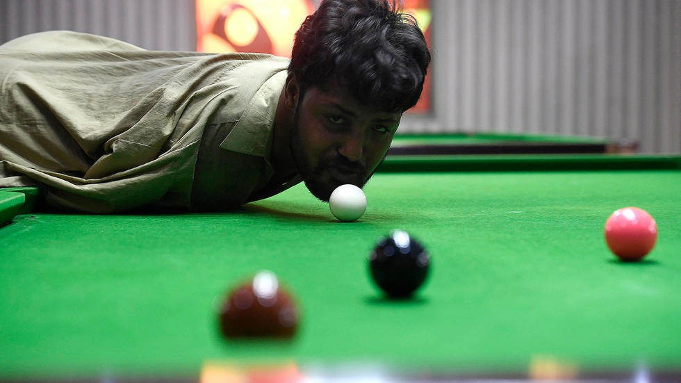 Born without arms, Pakistani snooker player masters the game