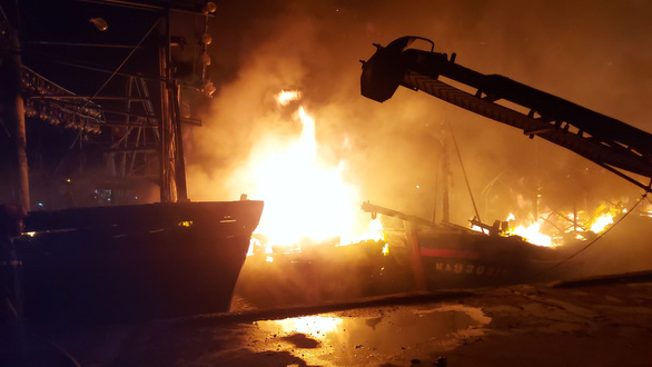 Several fishing boats ablaze in north-central Vietnamese province at night