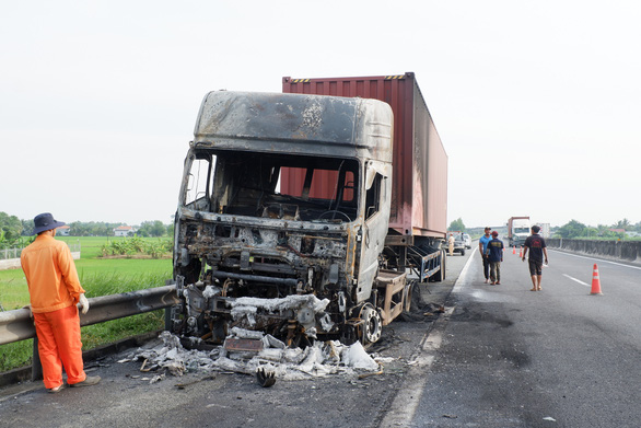 Tractor-trailer catches fire after sideswipe crash on Vietnam expressway
