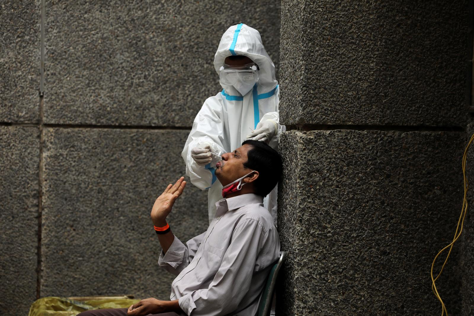 Global coronavirus cases rise by single-day record of half a million