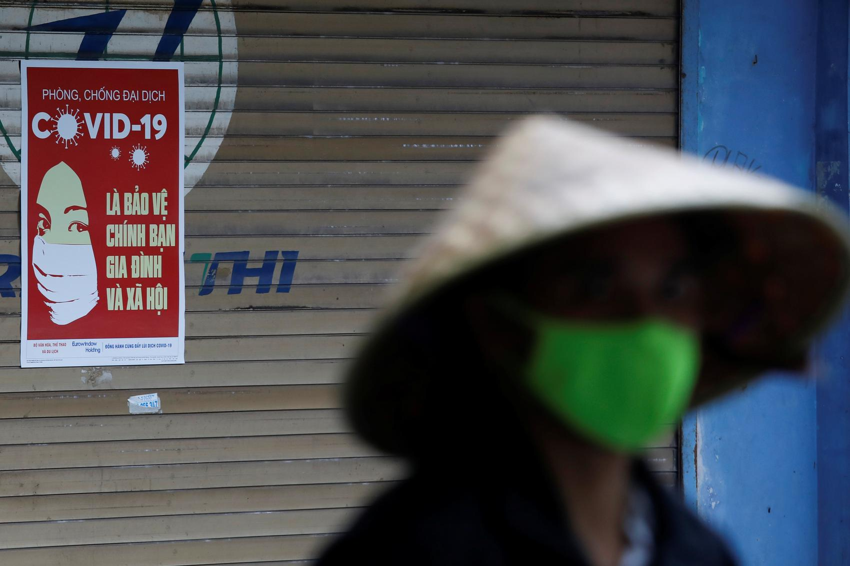Vietnam opts for containment over 'high risk' rush for costly vaccine