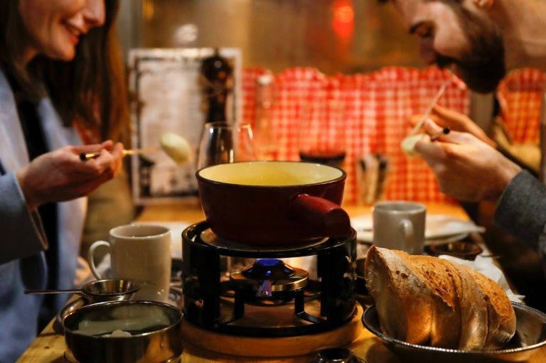 Swiss cheesed off over COVID-19 threat to fondue conviviality