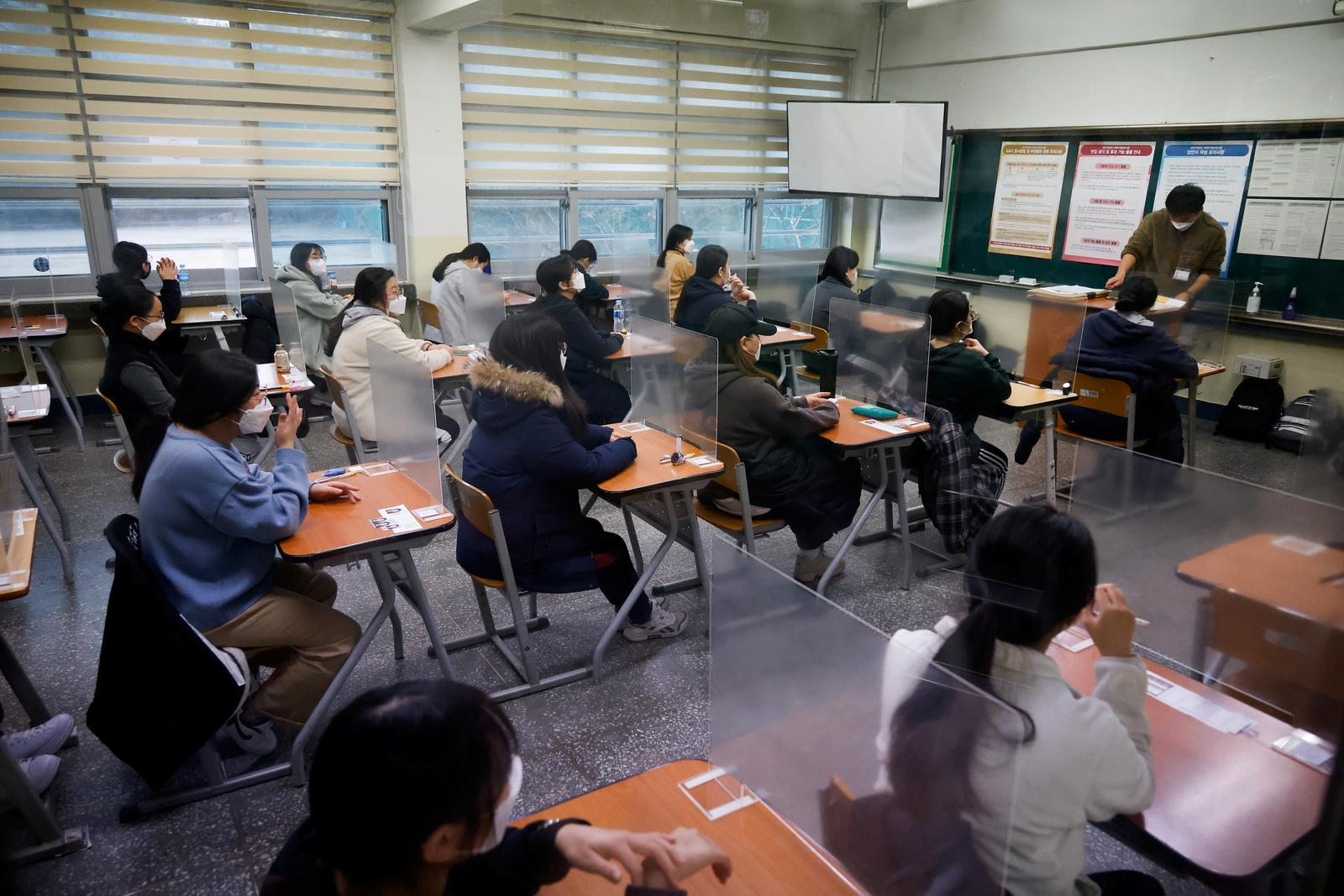 South Korea students sit college exam behind plastic barriers and in hospitals due to COVID-19