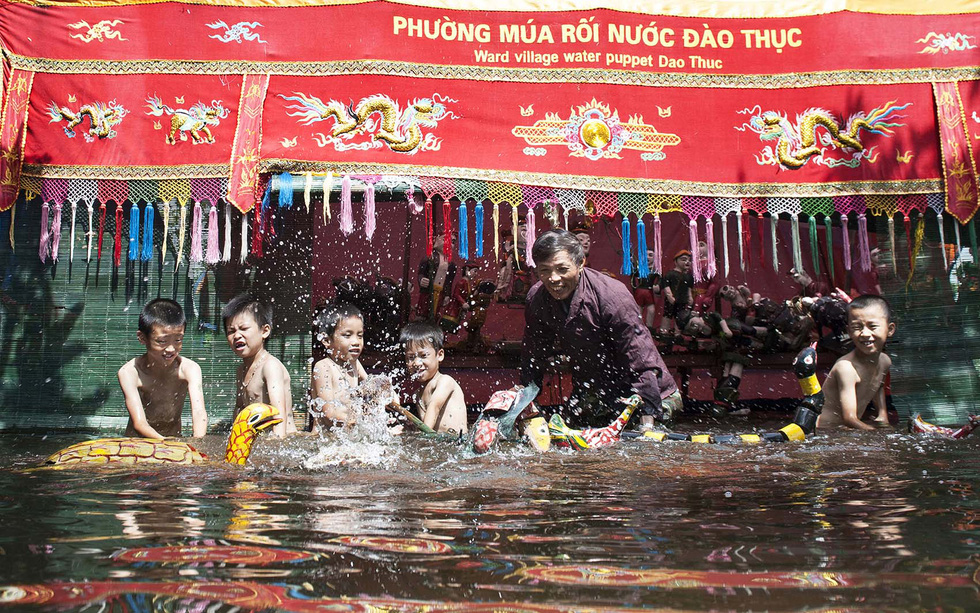 Check out this 300-year-old water puppetry village on the outskirts of Hanoi