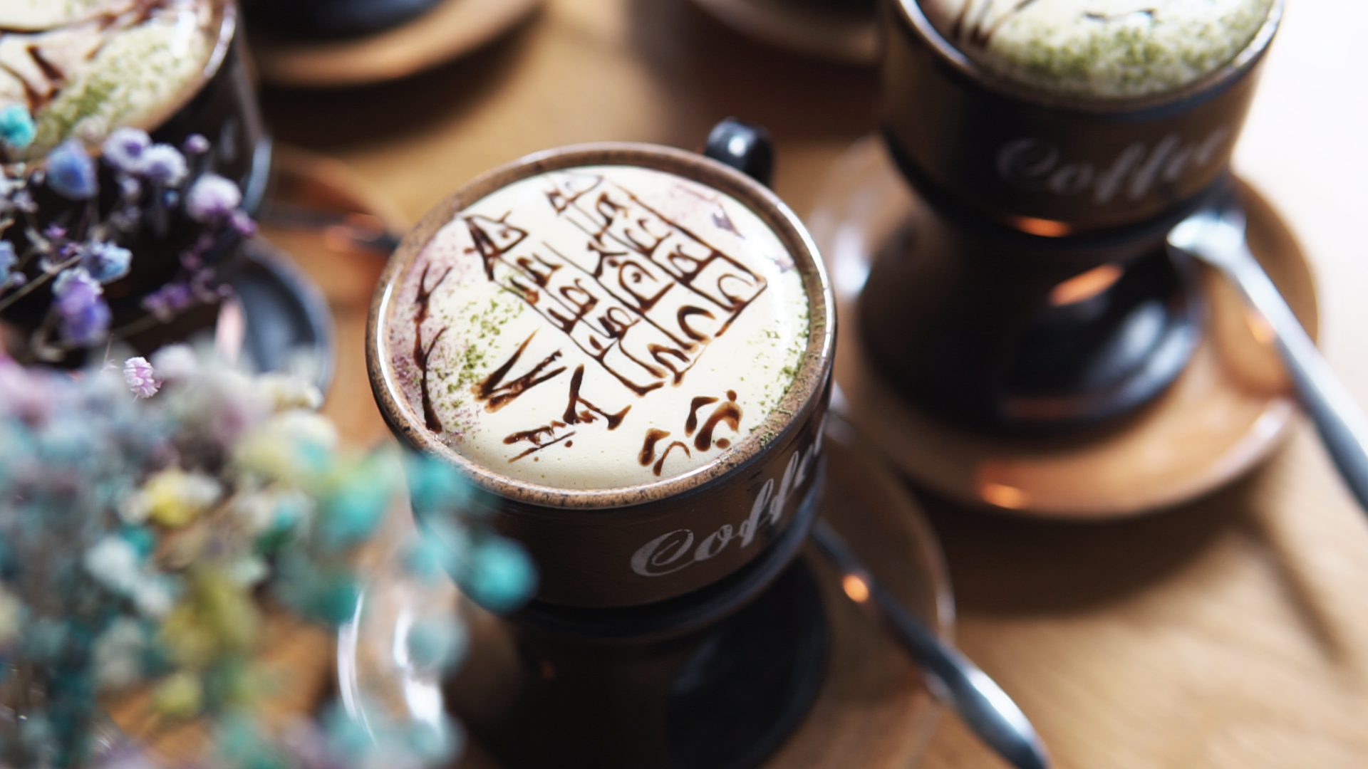 Saigon café serves up egg coffee with Vietnam's stunning sites on froth
