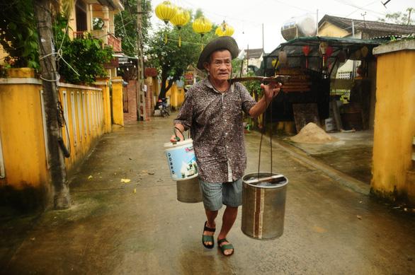 Buckets and a yoke: The last door-to-door water vendor in Vietnam's Hoi An