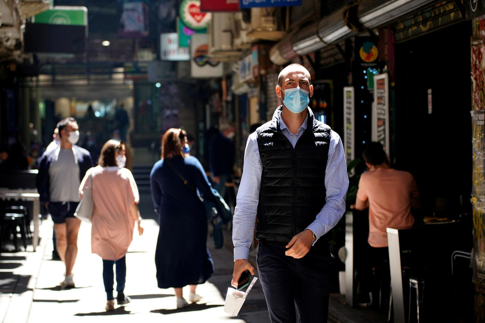 Australia's virus cluster expands further as masks made compulsory