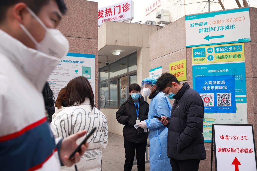 China steps up COVID curbs near Beijing as infections rise