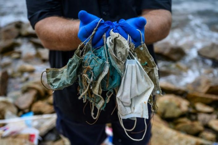 Single-use surgical masks have been found scattered around pavements, waterways and beaches worldwide since their use exploded during the coronavirus pandemic. Photo: AFP