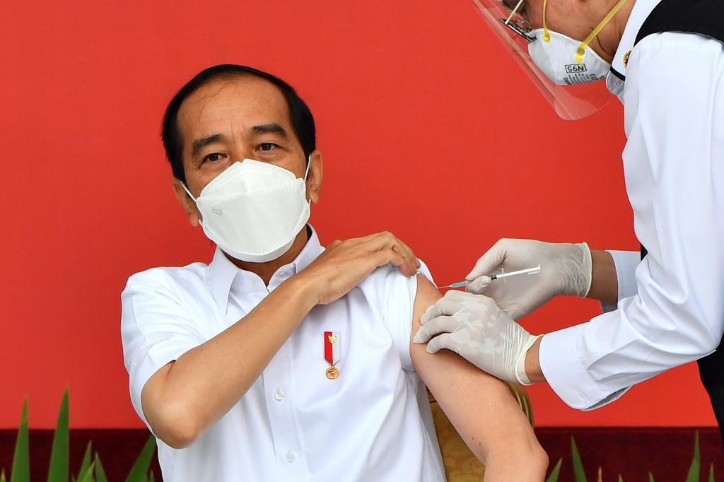Indonesia launches vaccination drive as COVID-19 deaths hit record