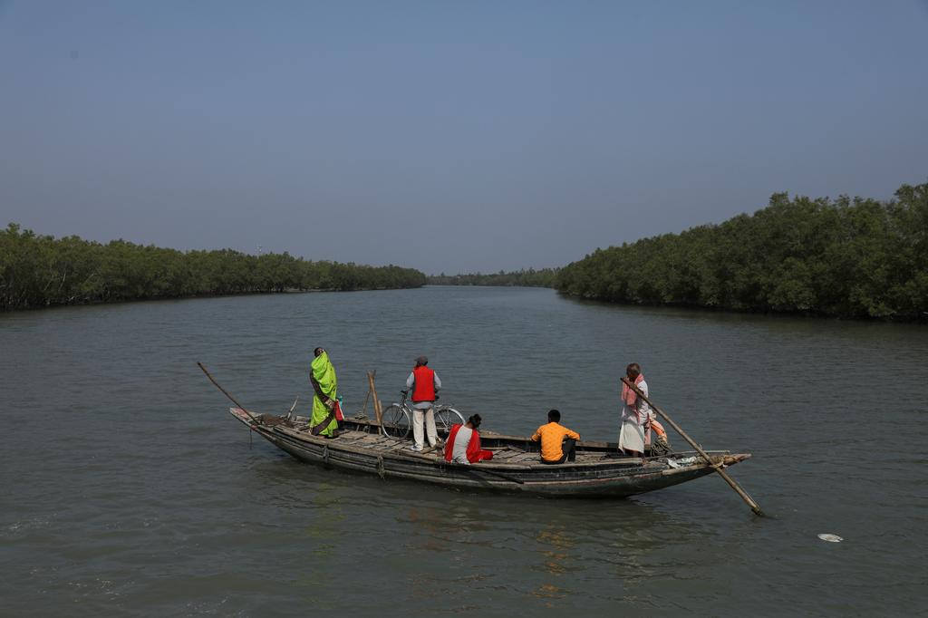 People travel on a boat near the island of Satjelia in the Sundarbans, India, December 16, 2019. Photo: Reuters