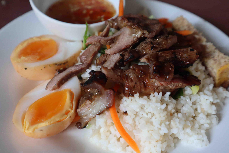 A plate of com tam includes grilled pork, trung kho long dao, steam egg at Com Tam Chi Nam, Tan Canh Street, Tan Binh District, Ho Chi Minh City. Photo: Nam Vuong / Tuoi Tre