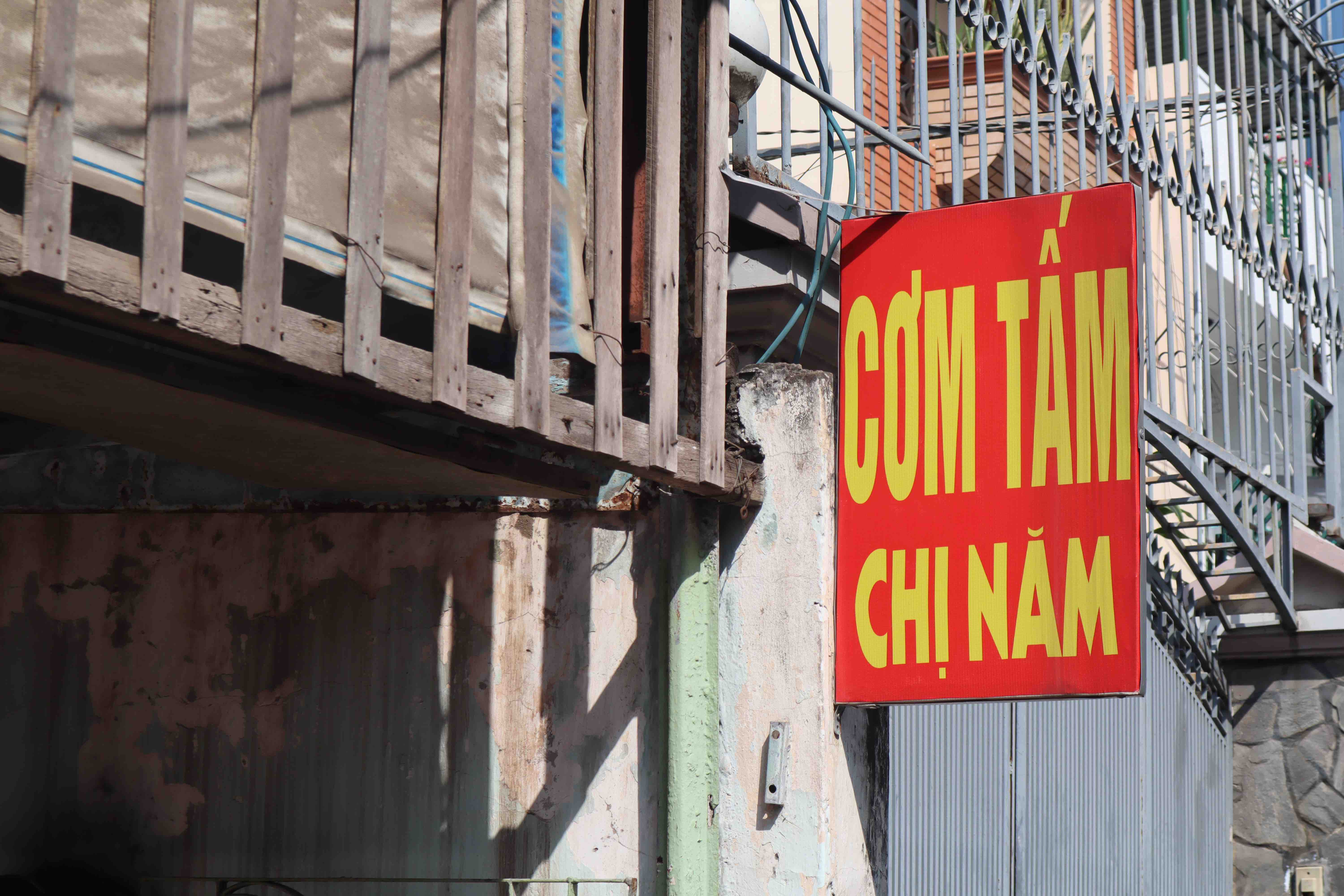 The Com Tam Chi Nam signboard at Tan Canh Street, Tan Binh District, Ho Chi Minh City, is seen in the photo. Photo: Nam Vuong / Tuoi Tre