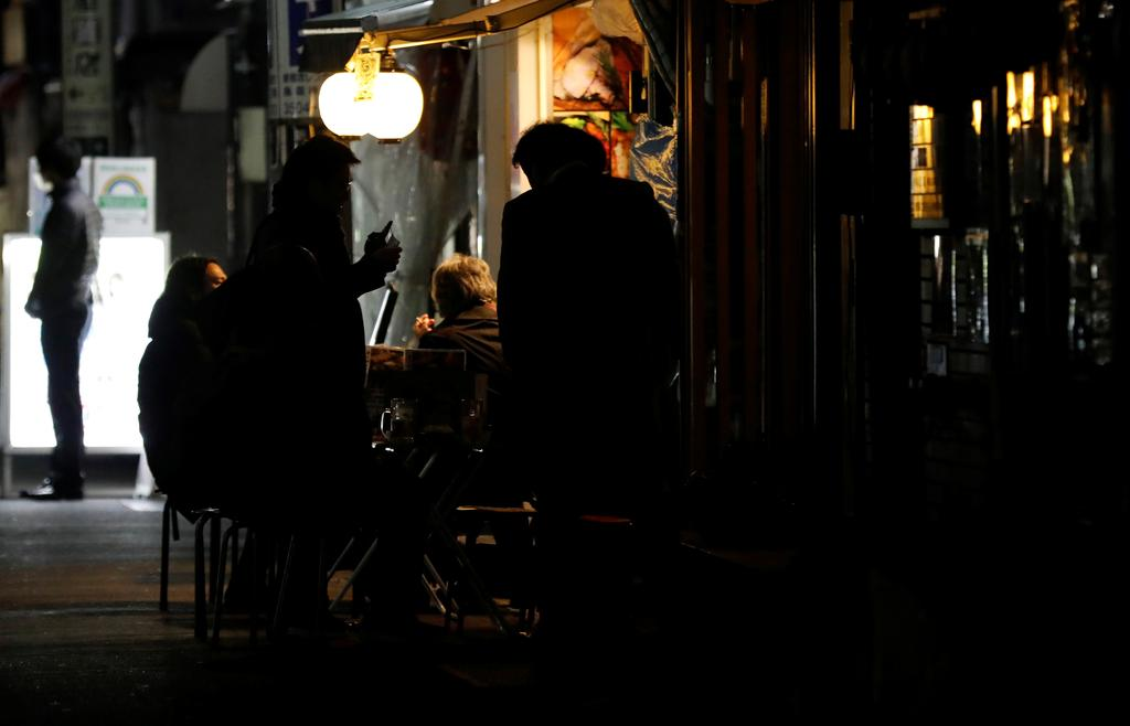 In Tokyo's lockdown, some drink on even after authorities call time