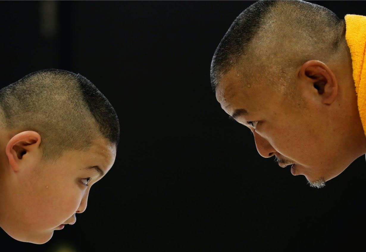 Kyuta practices sumo with his father during a one-on-one training session at the Buddhist temple Joshin-ji. Photo: Reuters