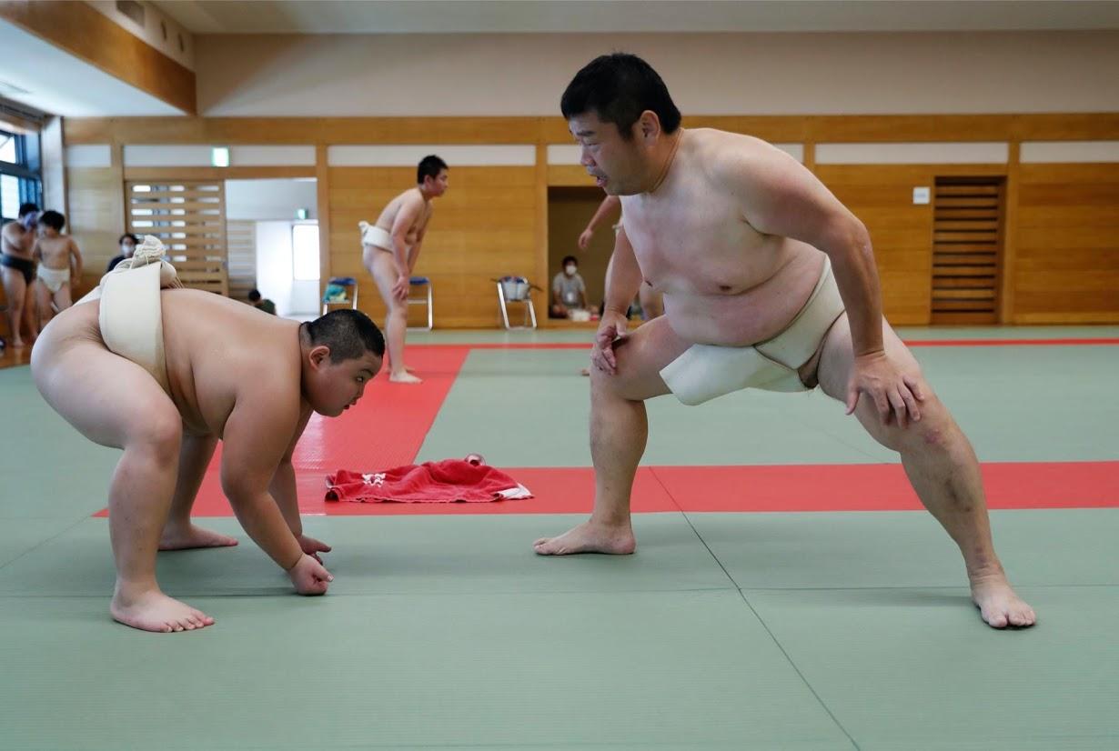 Kyuta practices sumo with his coach Shinichi Taira at Komatsuryu sumo club. Photo: Reuters