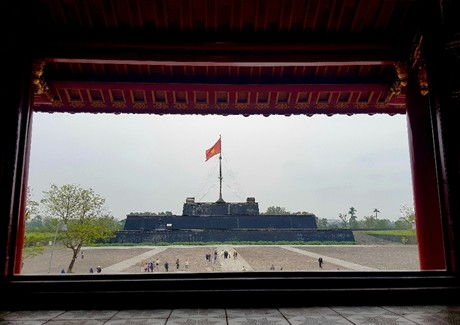 The Flag Tower is seen from the Meridian Gate's upper pavilion, known as Lau Ngu Phung (Pavilion of Five Phoenixes), at the Imperial City located within the citadel of Hue in Thua Thien-Hue Province, Vietnam, after its restoration. Photo: VGP