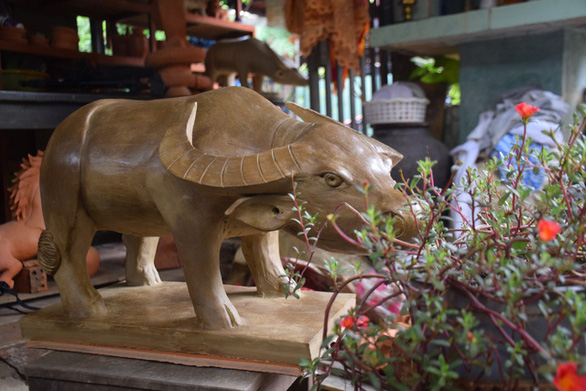 A clay buffalo is featured in a standing posture at Thanh Ha Pottery Village in Hoi An City, Quang Nam Province, Vietnam. Photo: D.T. / Tuoi Tre