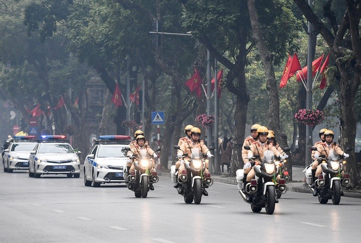 Traffic police officers under the Hanoi Department of Public Security patrol on a street following the ceremony on January 20, 2021. Photo: D. Le / Tuoi Tre