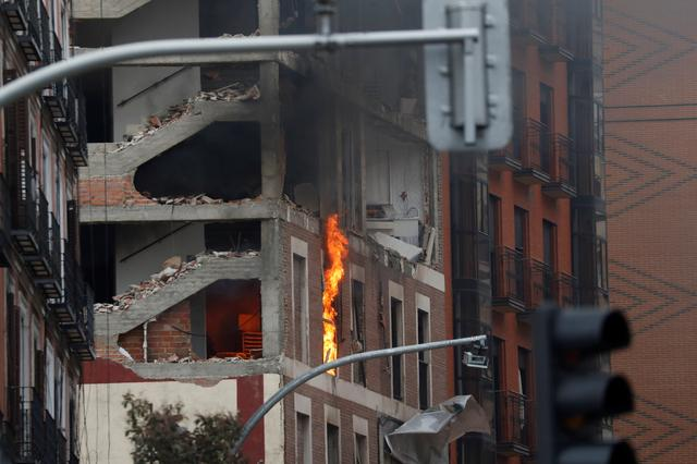 The building belonging to the Catholic Church burns after a deadly explosion, in Madrid downtown, Spain January 20, 2021. Photo: Reuters