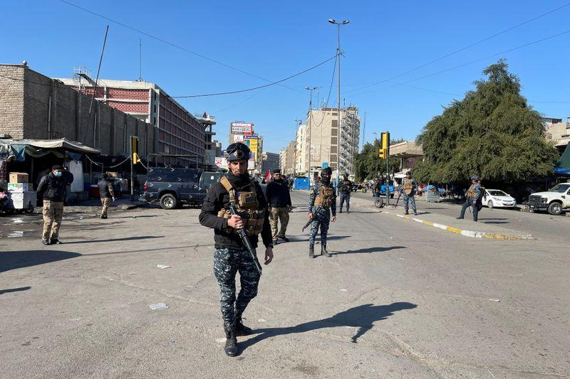 Rare twin suicide attack kills at least 13 in Baghdad