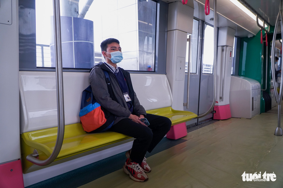 A visitor sits on the train for the metro line 3 of Hanoi, January 23, 2021. Photo: Pham Tuan / Tuoi Tre