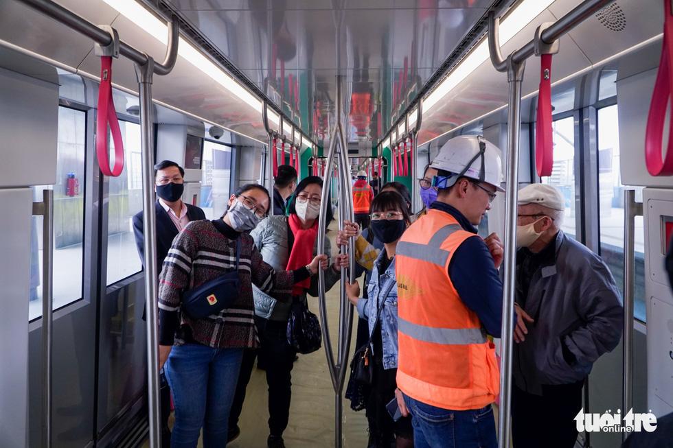 Visitors are seen on the train for the metro line 3 of Hanoi, January 23, 2021. Photo: Pham Tuan / Tuoi Tre