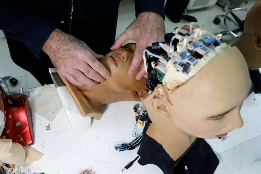 CEO David Hanson adjusts a face of a humanoid robot at Hanson Robotics' lab in Hong Kong, China January 12, 2021. Photo: Reuters