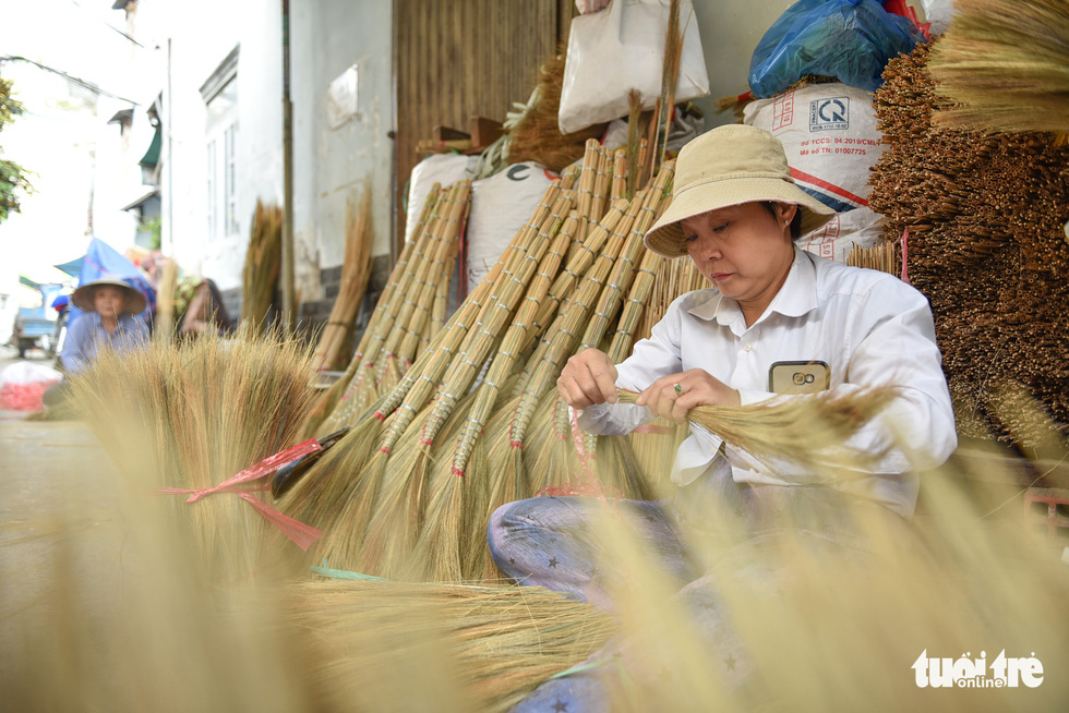 Hustle and bustle in a unique hamlet making brooms in Ho Chi Minh City