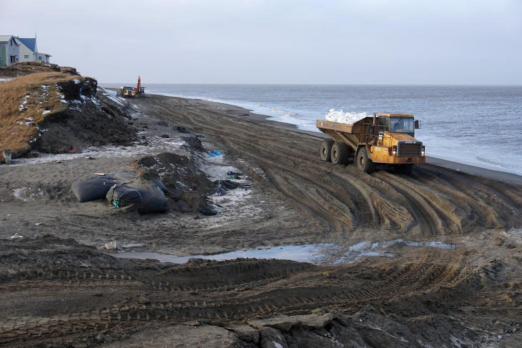 A view of Utqiagvik, formerly known as Barrow, Alaska, U.S. on October 4, 2018, with no sea ice on the horizon and North Slope Borough crews working to protect the shoreline from storm surges. Photo: Reuters