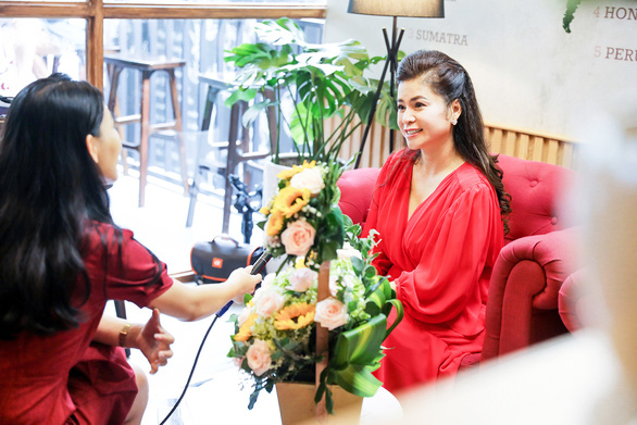 Le Hoang Diep Thao (right) talks with a reporter in an interview in a supplied photo