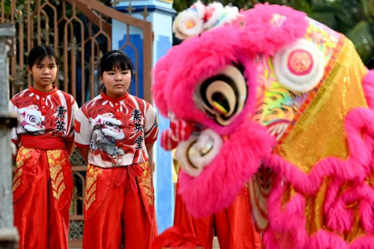There are now 20 women in the Tu Anh Duong lion and dragon dance troupe in Vietnam's southern city of Can Tho. Photo: AFP