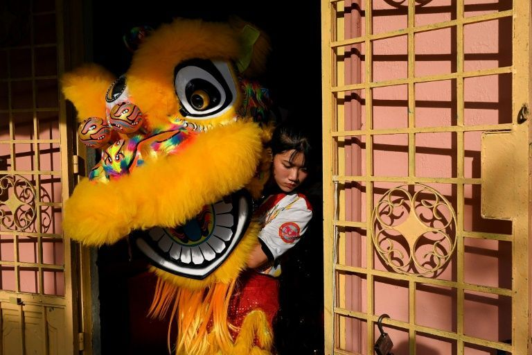 Nguyen Thuy Huong,17 is one of the 20 women in the Tu Anh Duong lion and dragon dance troupe in Can Tho city in southern Vietnam. Photo: AFP