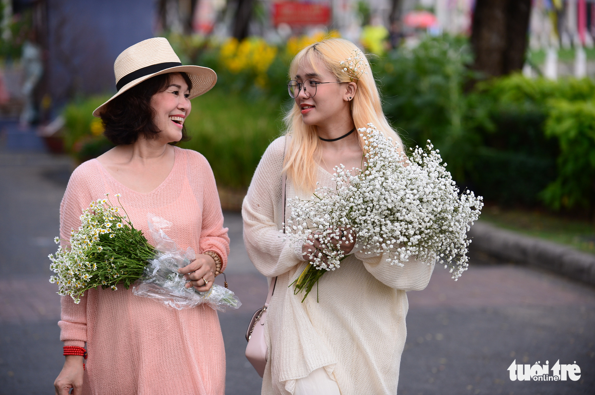People visit the Phu My Hung Spring Flowers Festival2021 in District 7, Ho Chi Minh City, February 4, 2021. Photo: Quang Dinh / Tuoi Tre