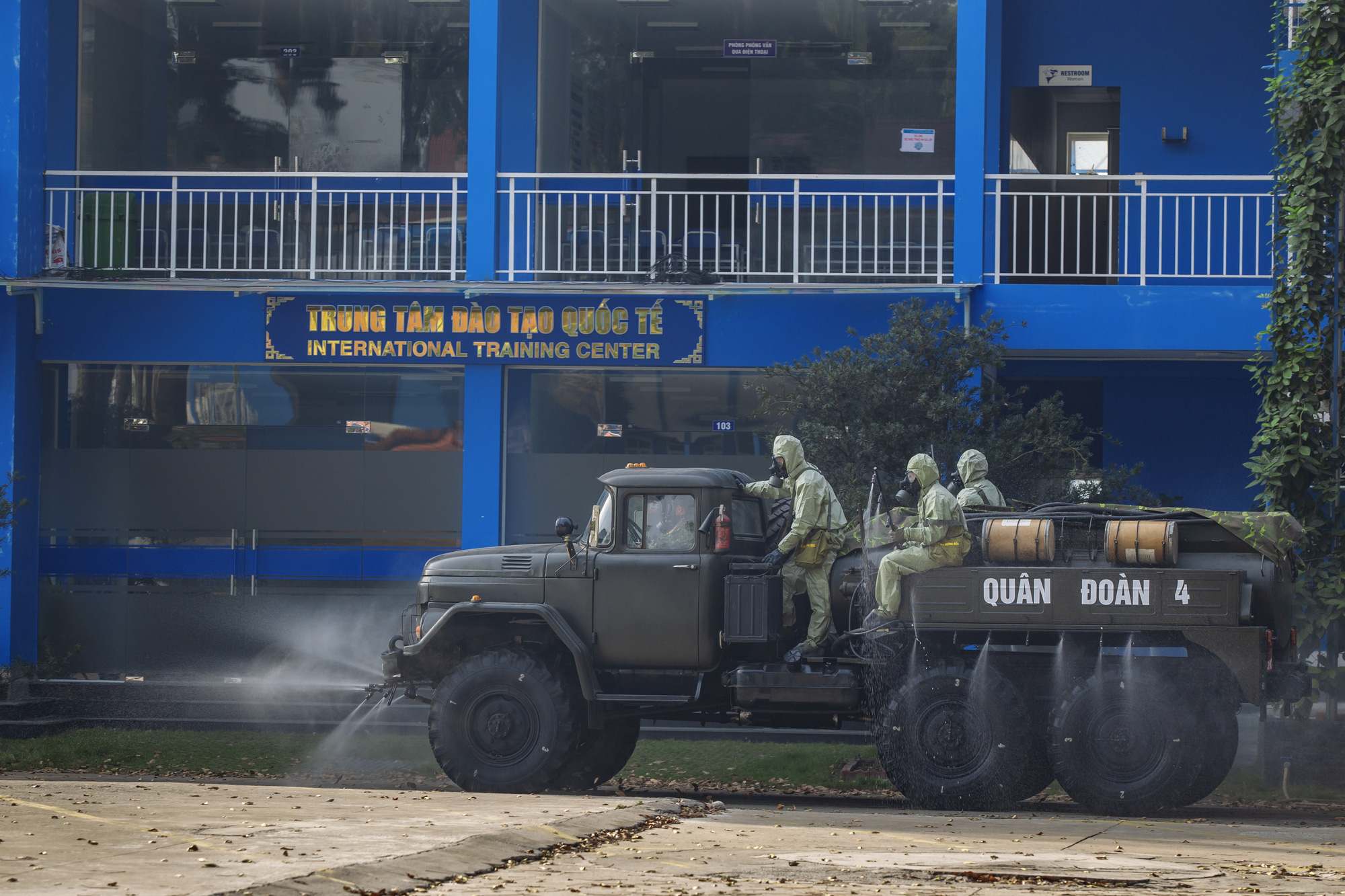 The military disinfects a section of Thu Dau Mot University in Binh Duong Province, Vietnam. Photo: Viet Hung / Tuoi Tre