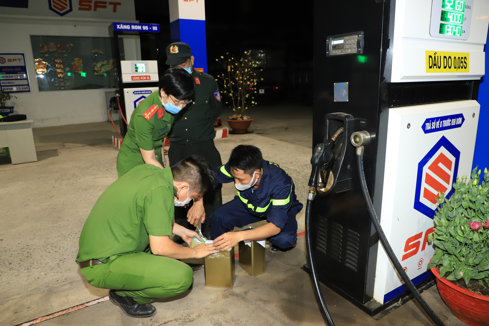 Officers examine a filling station in Dong Nai Province, Vietnam in this supplied photo.