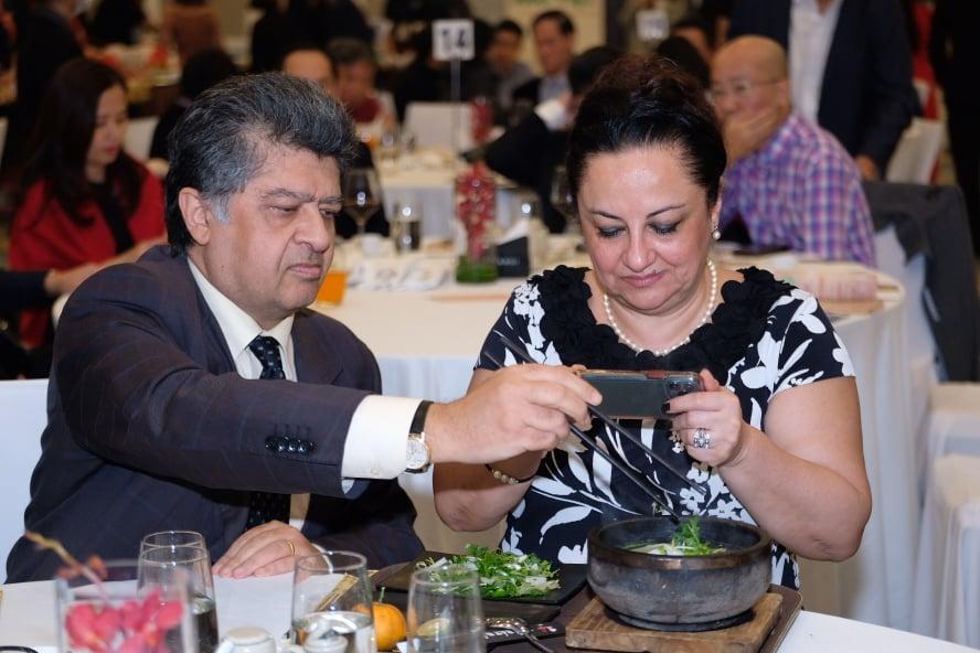 Armenia Ambassador to Vietnam Vahram Kazhoyan and his spouse enjoy pho at the gala night. Photo: Nam Tran / Tuoi Tre