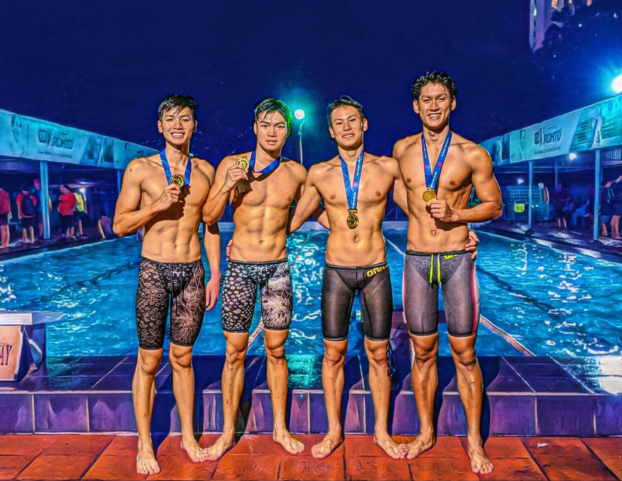 Swimmer Nguyen Huu Kim Son (left) and his Da Nang teammates are pictured with their medals at the National Swimming Championships in Ho Chi Minh City, October 2020. Photo: T.P. / Tuoi Tre