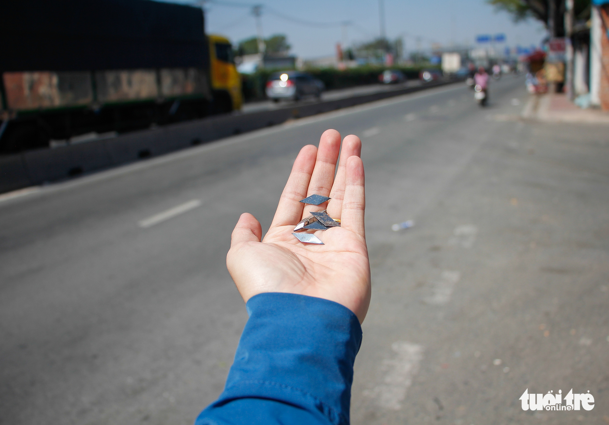Tire-puncturing nails are found on a street in Ho Chi Minh City. Photo: Chau Tuan / Tuoi Tre
