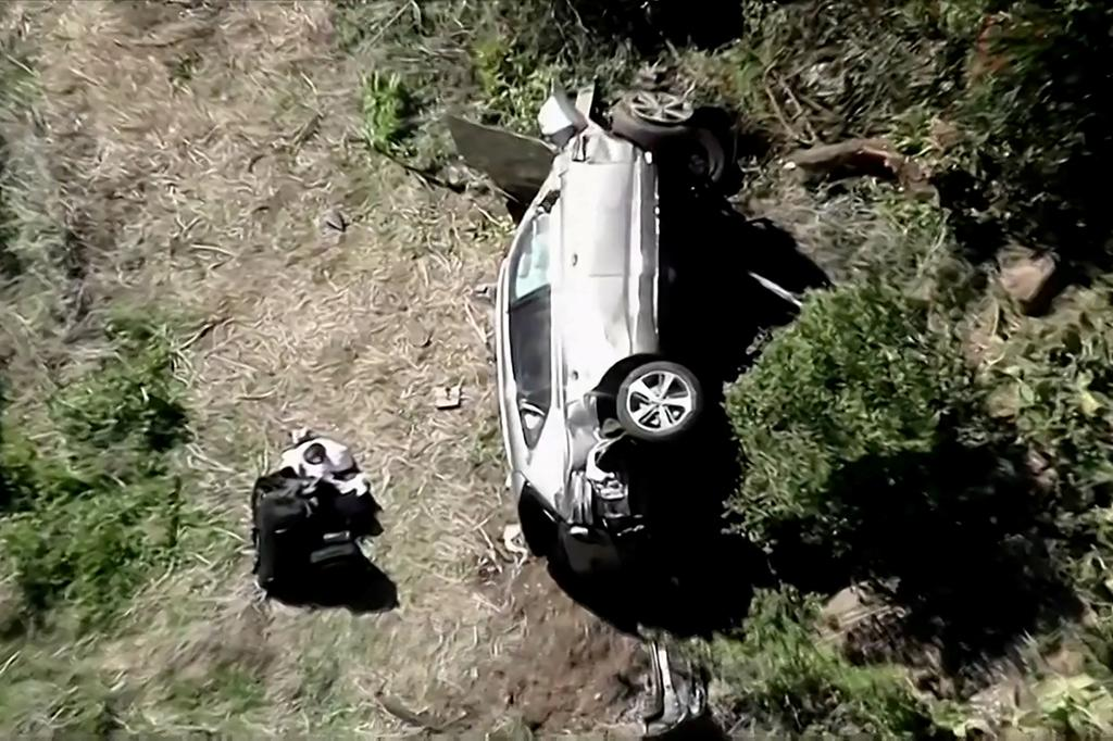 The vehicle of golfer Tiger Woods, who was rushed to hospital after suffering multiple injuries, lies on its side after being involved in a single-vehicle accident in Los Angeles, California, U.S. in a still image from video taken February 23, 2021. Photo: KNBC via Reuters