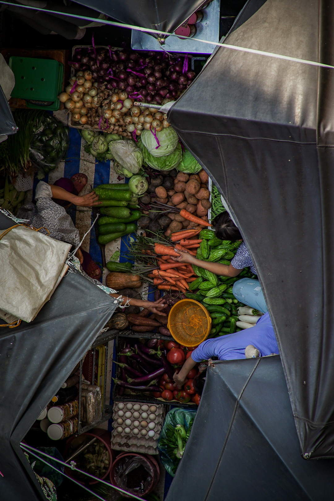 A photo from above by Van Nguyen shows vegetables being sold a local wet market in Saigon